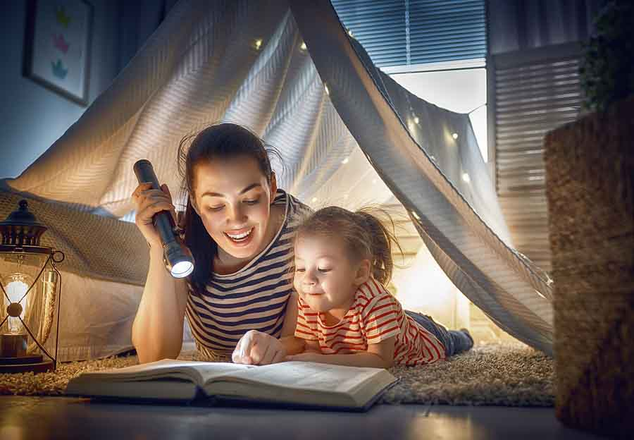 Here are some unexpected benefits of reading with your child.